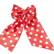 Royalty-Free Stock Photo: Dotted red satin gift bow and ribbon isolated on white