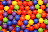 Background, colorful plastic balls on children's playground — Stock Photo