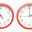Red wall clocks — Stock Photo