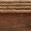 Old texture of wooden boards with ship rope. — Stock Photo