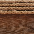 Old texture of wooden boards with ship rope. — Stock Photo #9244417