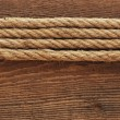 Ship rope and old wood background texture — Stock fotografie