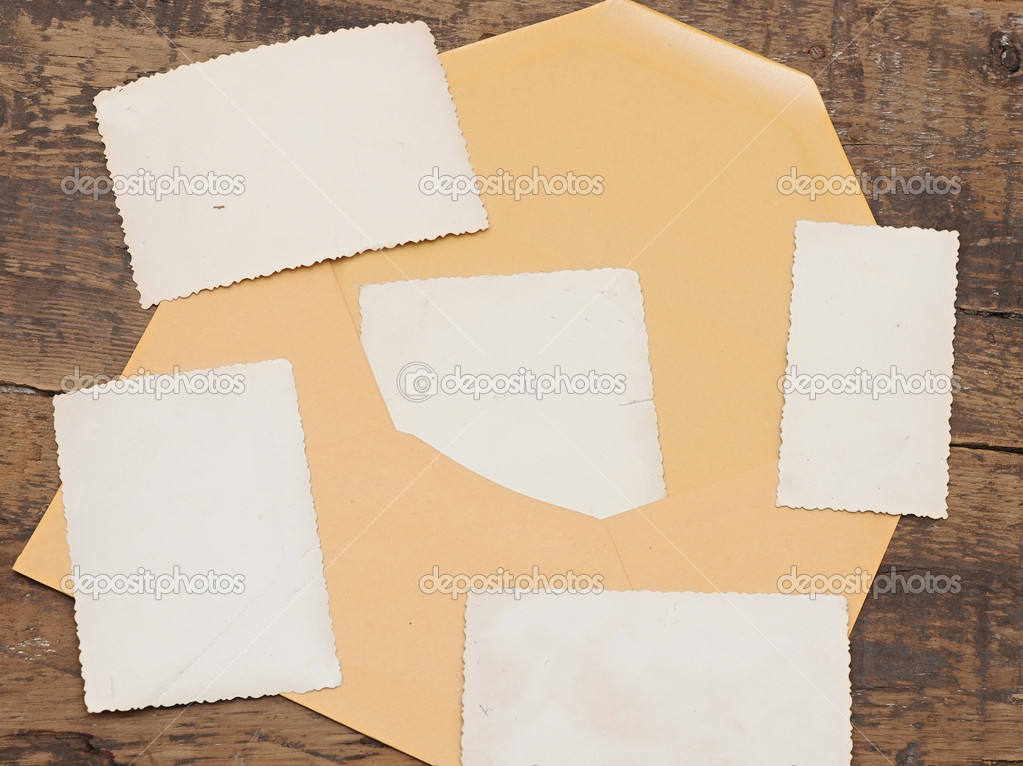 Vintage background with old photo and yellow envelope on old wood background — Stock Photo #9372171