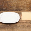Stock Photo: Empty dish with old paper