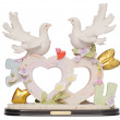 Stock Photo: Old romantic statuette with heart shape and doves isolated on w