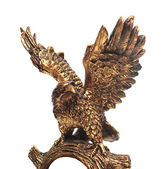 Golden eagle statue on a white background. — Stock Photo