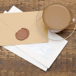 Envelopes with wax seal on coffee table — Stock Photo