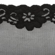 Black lace with pattern with form flower on white background — Stock Photo