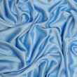 Smooth elegant blue silk can use as background — Stock Photo #9802621