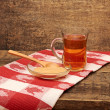 Tea and honey on wooden background — Stock Photo