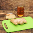 Stock Photo: Healthy ginger teon wooden background