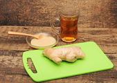 Healthy ginger tea on wooden background — Stock Photo