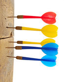 Darts hitting in wooden wall — Stock Photo