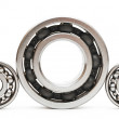 Big and small ball bearings on white background — Stock Photo