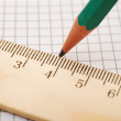 Closeup wooden ruler and pencil on background — Stock Photo