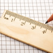 Closeup wooden ruler and pencil on background - Foto de Stock