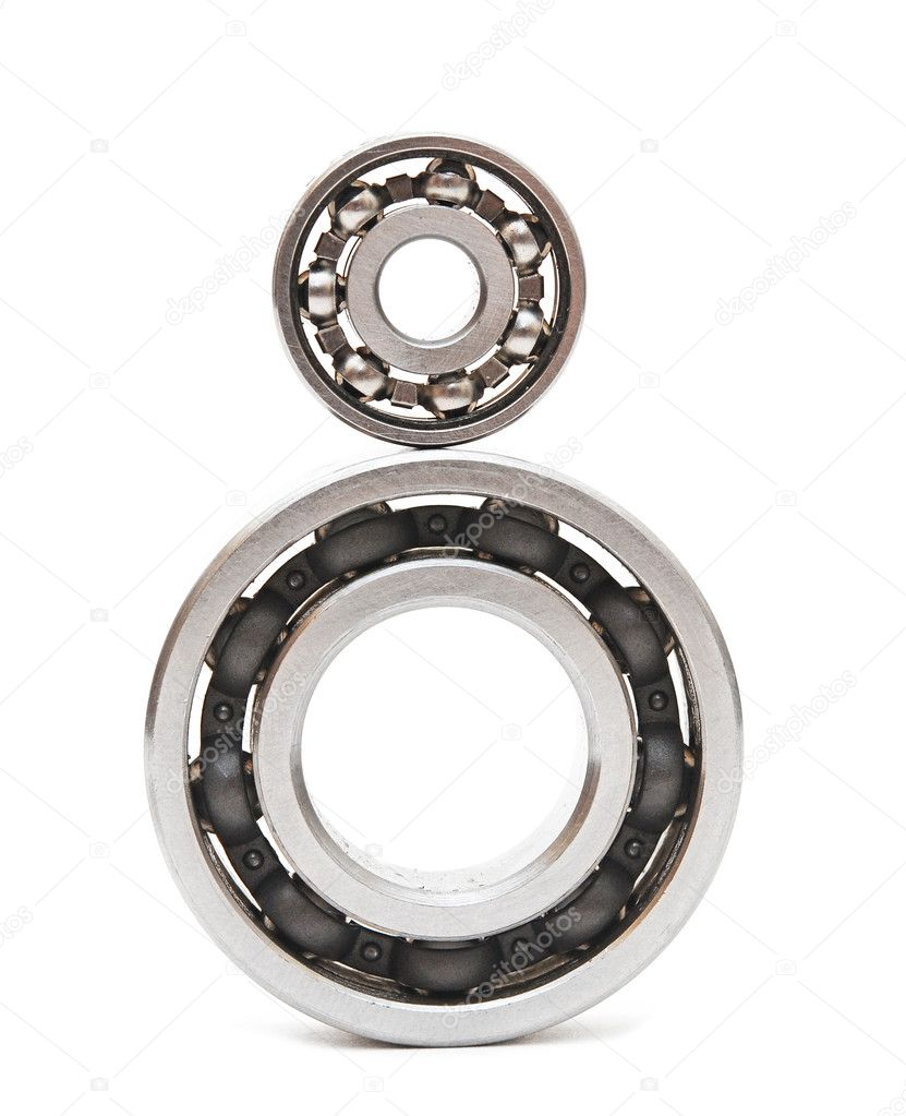 Big and small ball bearings on white background — Stock Photo #9910481