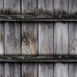 Fragment of old wooden fence - Stock Photo