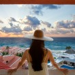 Woman with hat looking at the beach and sky — Stock Photo