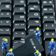 Stock Photo: Team of construction workers working on computer keyboard