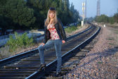 Girl stands on railway way — Stock Photo