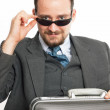 Businessman with sunglasses and briefcase — Stock Photo