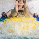 Girl having fun in the water park — Stock Photo