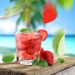 Fruit cocktail on a beach — Stock Photo #10098909