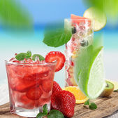 Fruit cocktail on a beach — Stock Photo