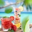 Fruit cocktail on a beach — Stok fotoğraf