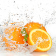 Orange fruits and Splashing water — Stockfoto