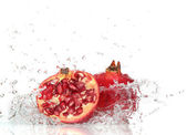 Fresh fruit with splashing water — Stock Photo