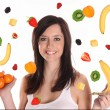 Young Brunette Woman with falling fruit over white — Stock Photo #8372675