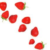 Fresas en splash de leche — Foto de Stock