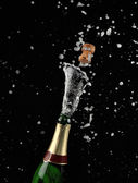 Close-up of explosion of champagne bottle cork — Zdjęcie stockowe