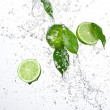 Fresh limes with water splash - Stock Photo