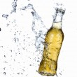 Beer bottle with splashing water — Stock Photo #8734729