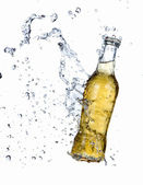 Beer bottle with splashing water — Stock Photo