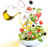 Fresh salad with poured olive oil — Stock Photo