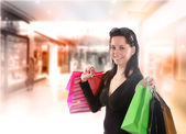 Shopping young woman in the shopping mall. — Stock Photo