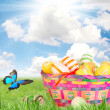 Colorful painted easter eggs in basket — Zdjęcie stockowe