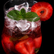 Strawberry cocktail over black background — Stock Photo