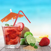 Fruit cocktail on a beach — Foto Stock
