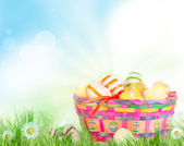 Colorful painted easter eggs in basket — Stock Photo