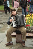 Young accordion player — Stock Photo