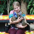 Young girl with a baby leopard — Stock Photo