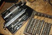 Retro calculating machine and abacus — Stock Photo