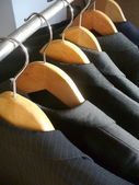 Row of men's suit jackets — Stock Photo