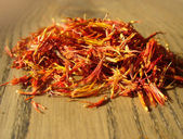 Pile of saffron on wooden background — Stock Photo