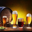 Beer barrel with beer glasses on a wooden table. — Stock Photo #10633097